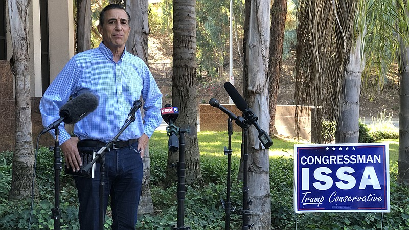 Darrell Issa speaks to reporters outside of his Vista campaign office in this...