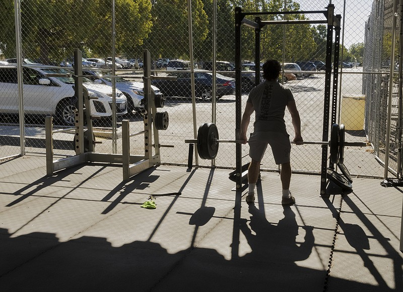 Point Loma resident Nate Dimelfi lifts weights at Point Loma Sports Club's pa...