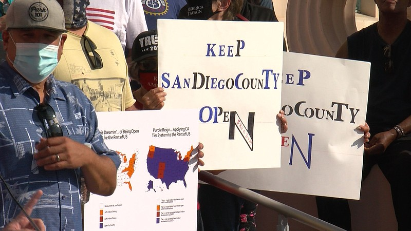 Business owners protest outside of the San Diego County Administration buildi...