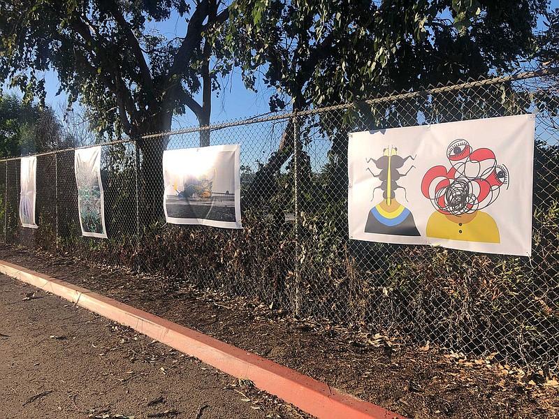 Works of art on large banners grace a parking lot at San Diego Mesa College, ...