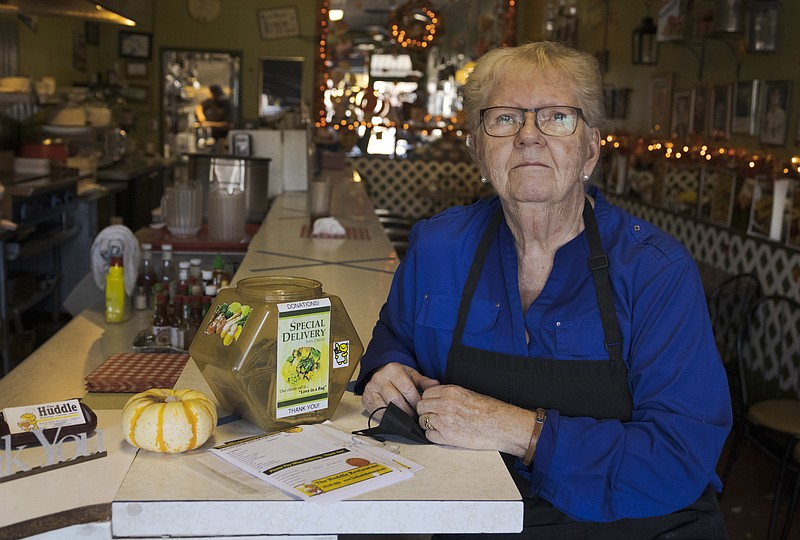 Ruth Henricks, owner of The Huddle, sits at the bar of her restaurant in Miss...