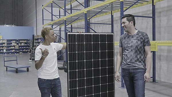 Sunrun lead installer shows a rooftop solar panel to