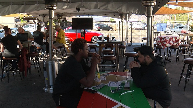 People eating outside at Eastbound Bar and Grill in Lakeside, Nov. 11, 2020.
