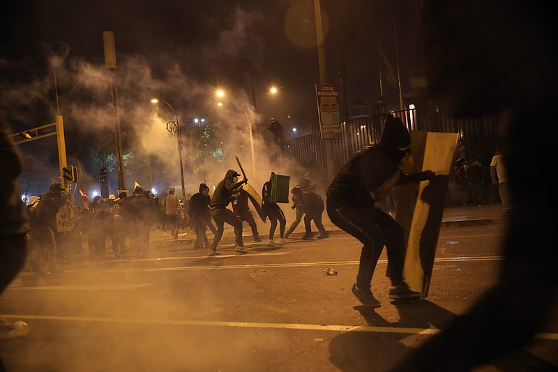 Police launch tear gas to disperse protesters who gathered in Plaza San Marti...