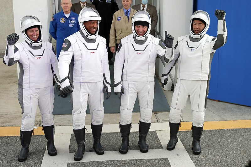 NASA astronauts, from left, Shannon Walker, Victor Glover, and Michael Hopkin...