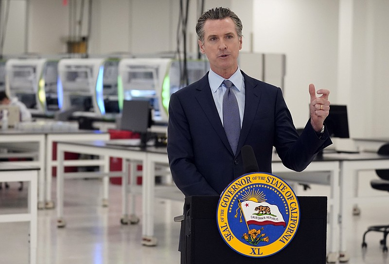 In this Oct. 30, 2020, file photo, California Gov. Gavin Newsom speaks at a C...