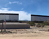 Thirty-foot-high border wall was installed alon...