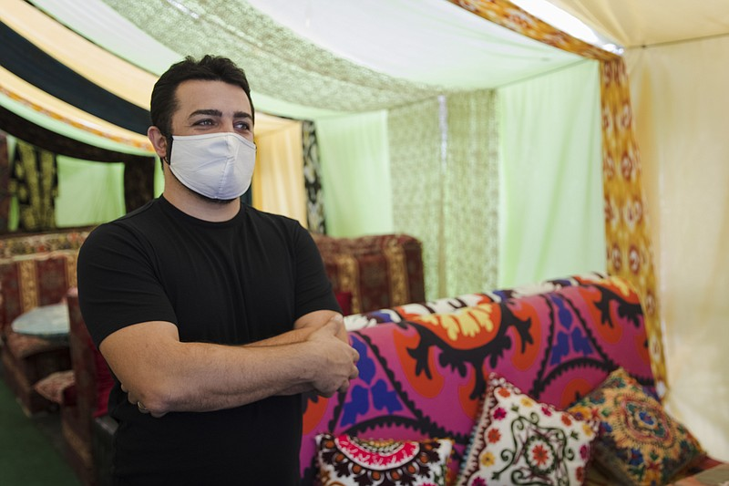Restaurateur Ike Gazaryan stands in the Bedouin-style tent he's constructed i...