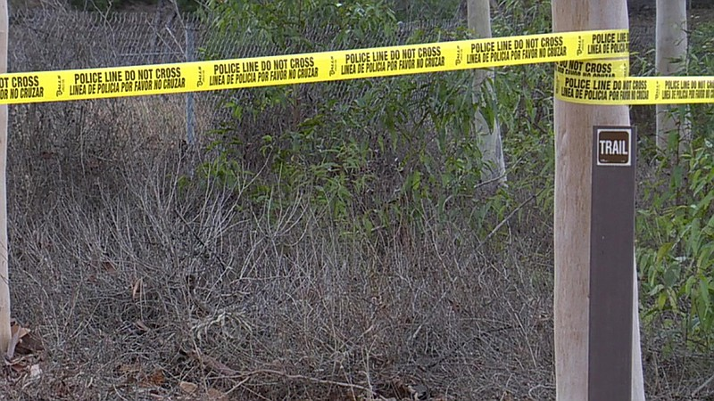 Police tape on the Hosp Grove Trail East in Carlsbad where police found the b...