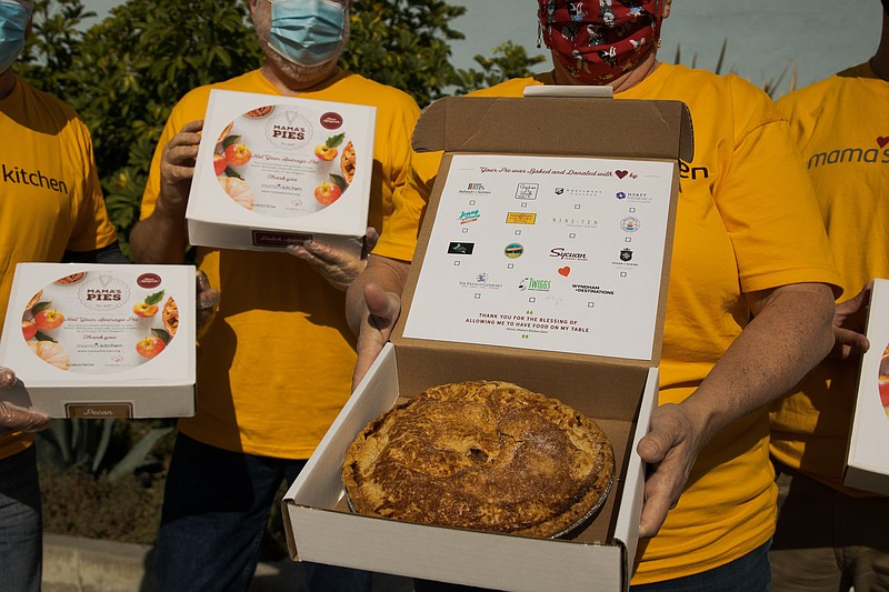 Volunteers showing off pies from Mama's Kitchen on Nov. 25, 2020.