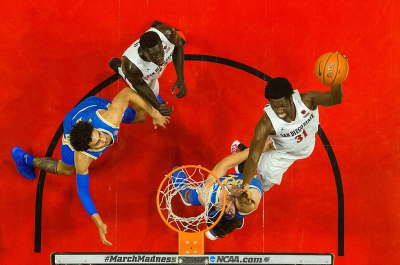 San Diego State's Nathan Mensah on a layup against No. 20 UCLA on Nov. 27, 2020