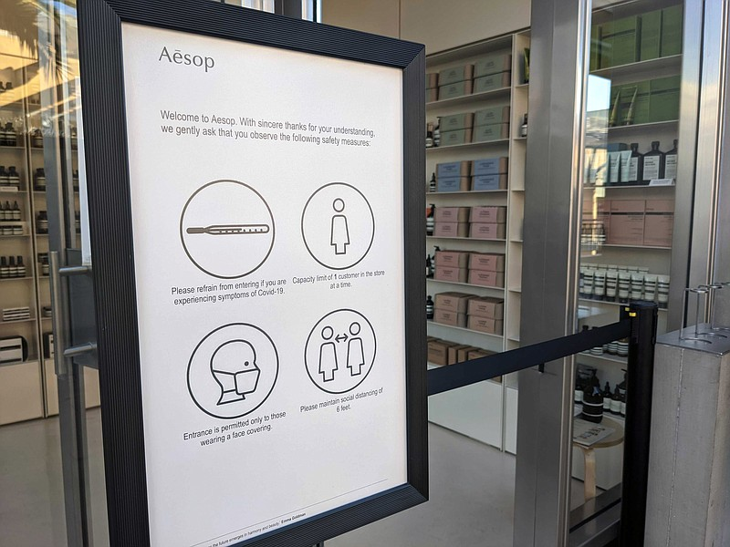 A sign in front of the Aesop store in Fashion Valley Mall advising people to ...