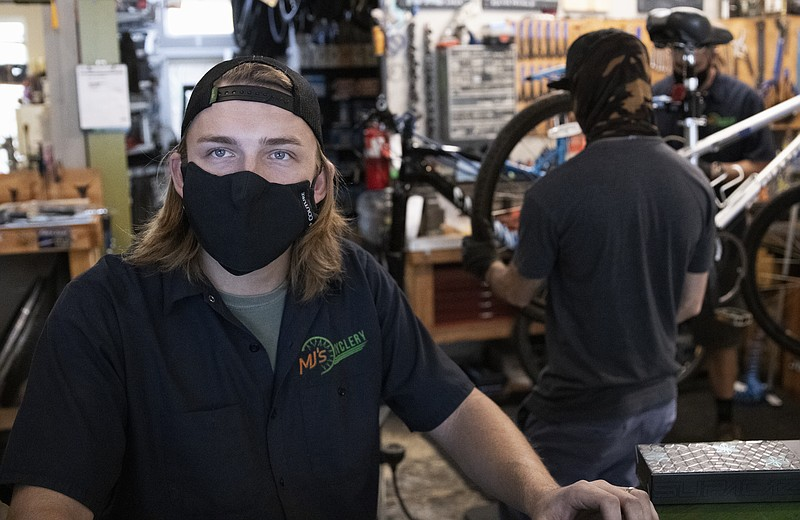 Manager Andrew Hargis of MJ's Cyclery in Hillcrest stands in his shop, Dec. 8...