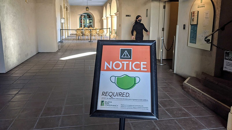 A sign indicating masks were required at The Prado restaurant in Balboa Park,...