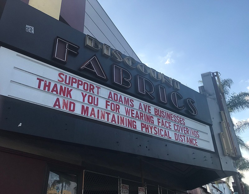 A sign thanks patrons of Adams Avenue businesses for following COVID-19 preca...