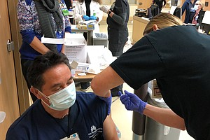 Photo for California Sees Hopeful Signs As Counties Fight For Vaccines