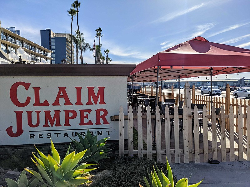 An outdoor dining area at Claim Jumper Restaurant in the Embarcadero sits emp...