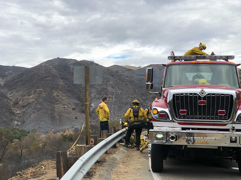 Firefighters observe the Creek Fire from their firetruck in Fallbrook, Dec. 2...