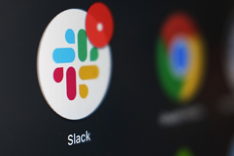 This Dec. 2, 2020, file photo shows the Slack app icon being displayed on a c...
