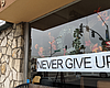 A sign is shown in a Carlsbad restaurant defyin...