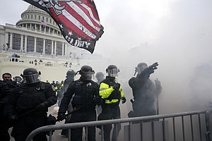 Photo for Prosecutors: No Charges For Officer In Capitol Riot Shooting