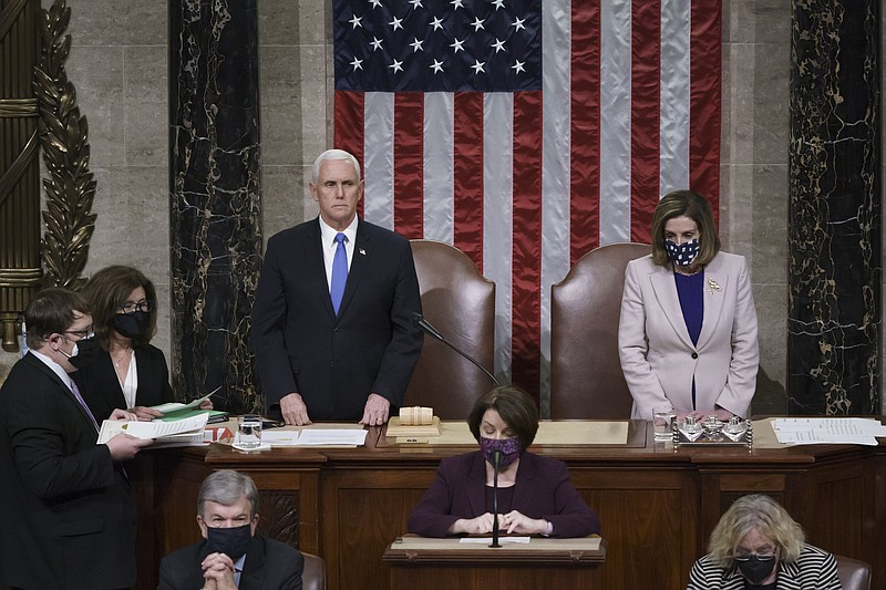 Vice President Mike Pence and Speaker of the House Nancy Pelosi, D-Calif., re...