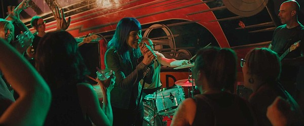 The fictional band Xenos performs in the Whistle Stop in ...