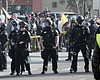 San Diego police officers forming a chain separ...