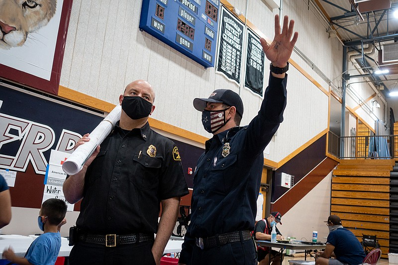 Emergency responders are shown at Steele Canyon High School, a temporary evac...