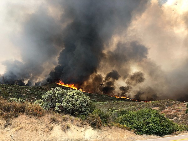 Flames on Sept. 6, 2020, from the Valley Fire are shown f...
