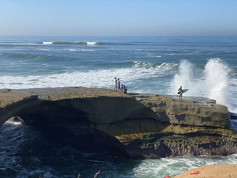 People watching the high surf at Sunset Cliffs in San Diego County. Jan. 9, 2...