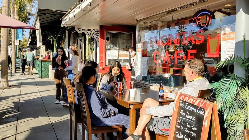 Patrons dining in front of Encinitas Cafe on Jan. 3, 2021, which was opened i...