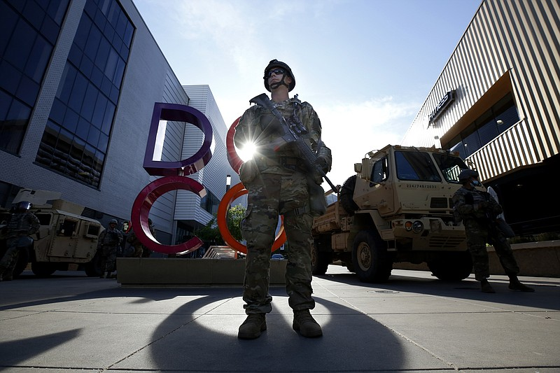 Members of the California National Guard stand watch at the Downtown Commons ...