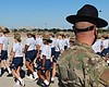Trainees march in formation at Joint Base San A...