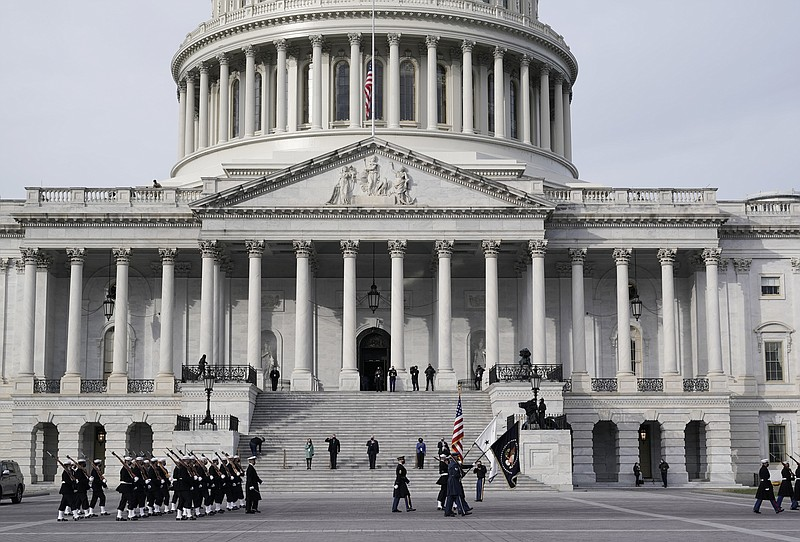 U.S. military units march in front of the Capitol, Monday, Jan. 18, 2021 in W...