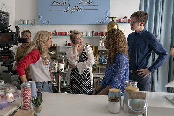 Writer-director Emerald Fennell (center) on the set of he...