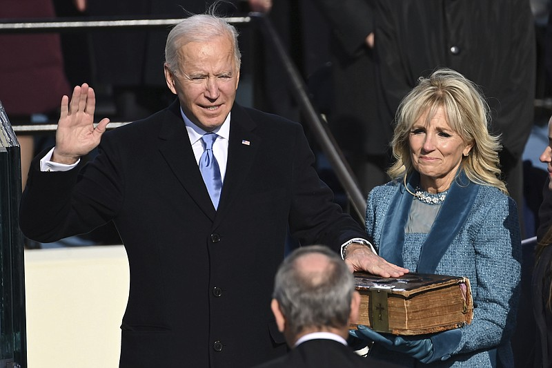 Joe Biden is sworn in as the 46th president of the United States by Chief Jus...