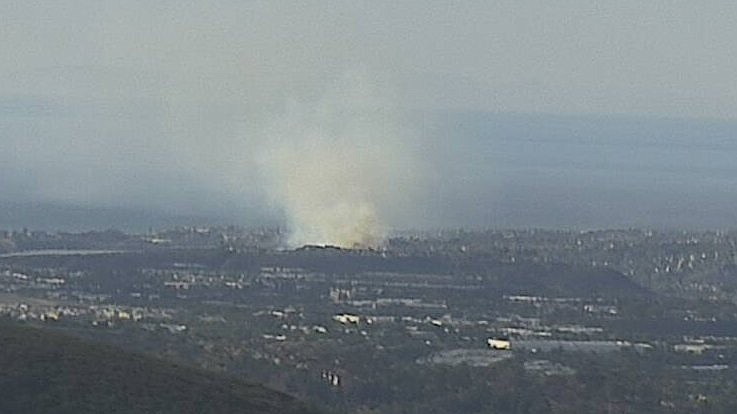 Smoke rises from a Park Fire in Carlsbad, Jan. 20, 2021.