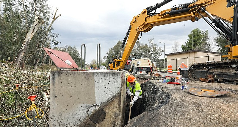 Workers exvacating and installing new pipes on the historic First Aqueduct in...