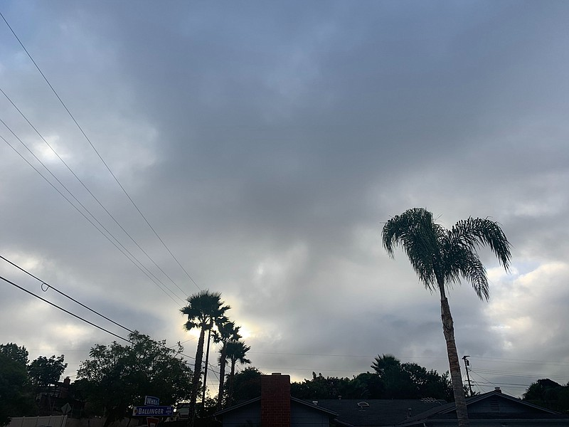 Storm clouds form over the San Carlos area in San Diego, Jan. 22, 2021.
