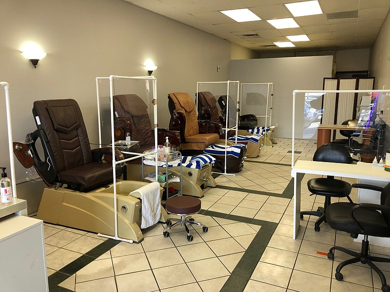 The interior of London Nail Spa in Point Loma is shown with safety modificati...