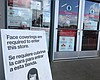 A sign advising of the store's COVID-19 prevent...
