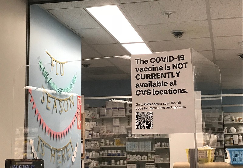 A sign at a CVS pharmacy reads