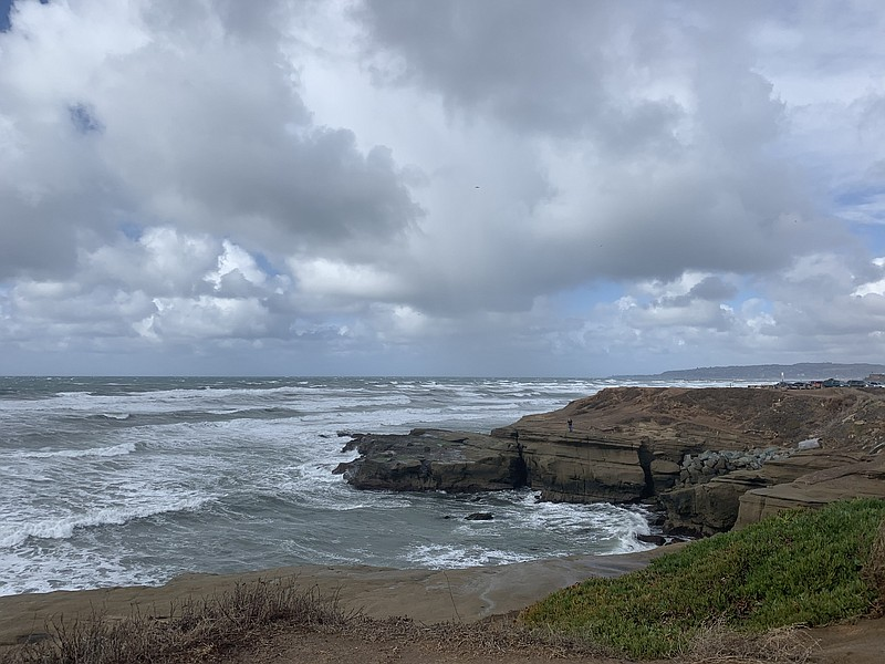 A winter storm gathers off the coast of Sunset Cliffs in San Diego, Jan. 25, ...
