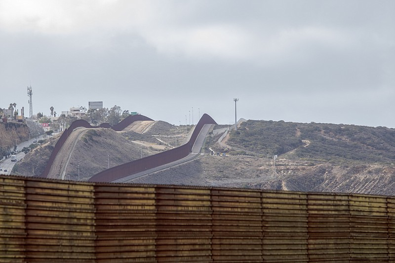 The recently completed border fence replacement along the border of Tijuana a...