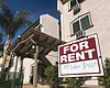 A sign advertises a one bedroom apartment for r...