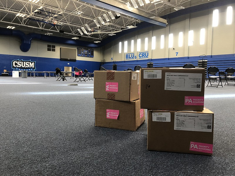 Four boxes of medical supplies are stacked on the ground of the Cal State Uni...