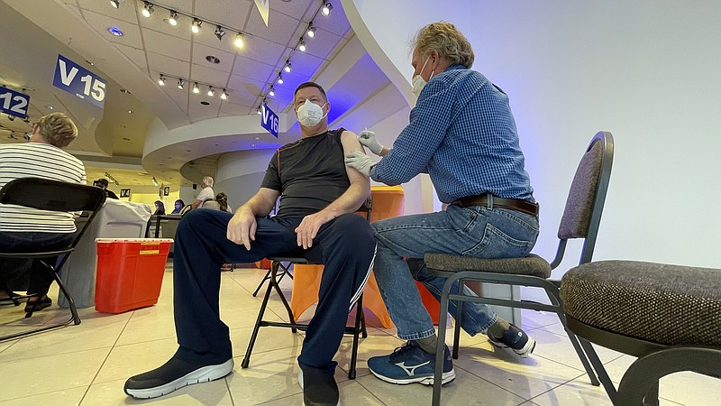 A man getting the COVID-19 vaccine at the Grossmont Center vaccination super ...