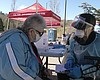 80-year-old Tera Parker gets a COVID-19 vaccine...