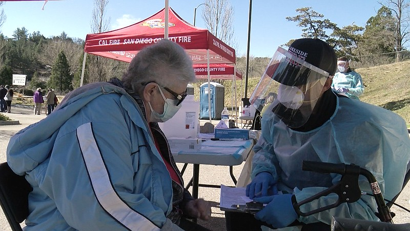 80-year-old Tera Parker gets a COVID-19 vaccine outside the Julian Library, F...